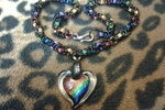 http://temp_thoughts_resize.s3.amazonaws.com/1b/d2d480449011e6871a0b51451ccbfa/glitter_rainbow_glass_heart_necklace_by_catsmice8-d6efvl6.jpg